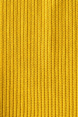 close up view of bright yellow woolen fabric as backdrop
