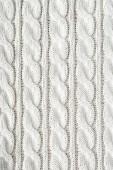 telaio completo di panno bianco lavorato a maglia con motivo come sfondo