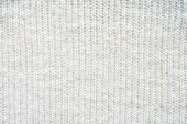 Fotografia telaio completo di sfondo bianco tessuto di lana