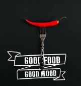 Red hot chilli na vidličku na černém pozadí s dobrým jídlem - dobrou náladu inspirace