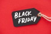 Fotografie shopping sale tag with black friday sign on red