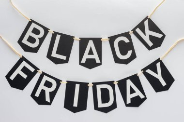 black friday lettering on flag garlands for special offer isolated on white