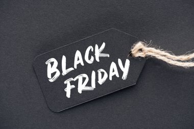 close up of sale tag with black friday sign on black