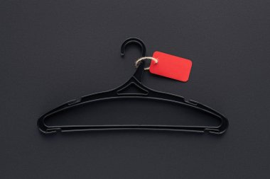 top view of hanger with empty red sale tag for black friday