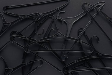 background with black hangers on black, top view for black friday
