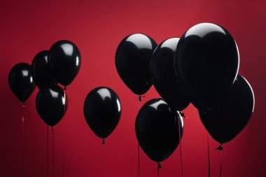 background with black balloons on red for black friday
