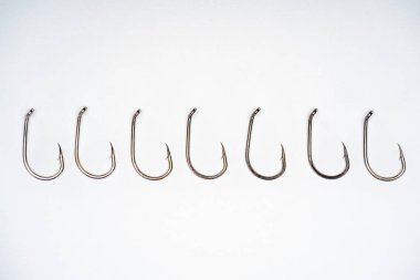 Top view of fishing hooks placed in row isolated on white stock vector