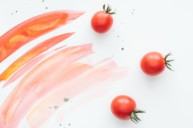 top view of delicious cherry tomatoes on white surface with red watercolor strokes