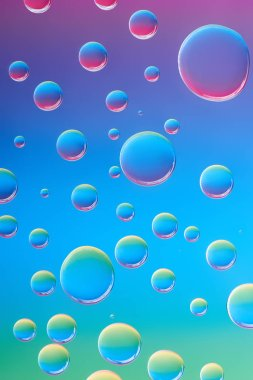 close-up view of beautiful calm transparent water drops on bright abstract background