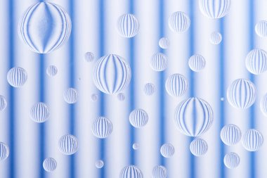 close-up view of transparent water drops on striped white and blue background