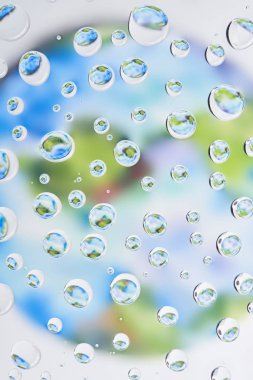 Close-up view of beautiful clear water drops on blurred abstract background stock vector