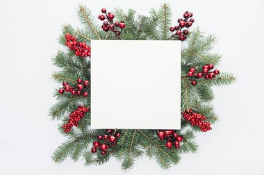 top view of pine tree wreath with Christmas decorations and square blank space in middle isolated on white