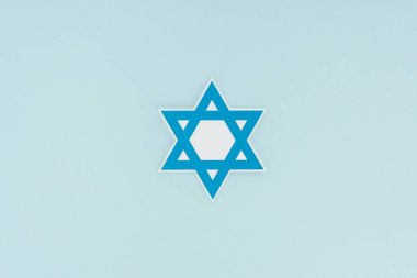 Top view of traditional jewish star isolated on blue, hannukah holiday concept stock vector