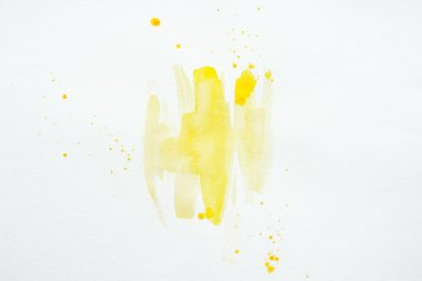 Abstract yellow watercolor splatters on white paper background stock vector