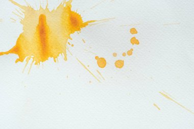 Abstract orange watercolor splatters on white paper background stock vector