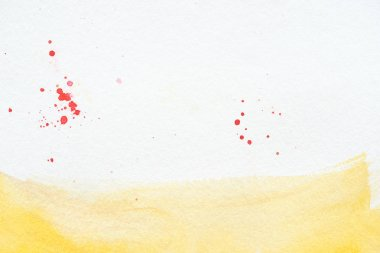 Yellow watercolor stroke with red splatters on white paper background stock vector
