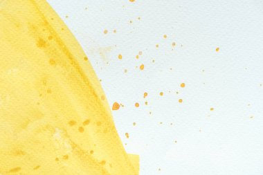 Abstract close up background with yellow watercolor stroke with splatters stock vector