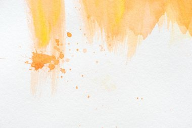 Abstract orange watercolor painting with splatters on white paper stock vector