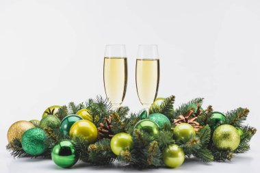 Close up view of glass of champagne and festive christmas wreath on white backdrop stock vector