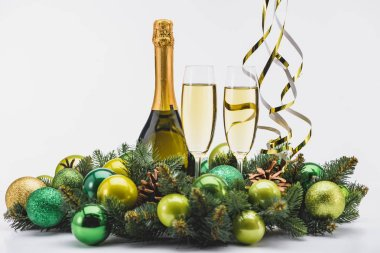 Close up view of bottle and glasses of champagne with christmas wreath on white background stock vector