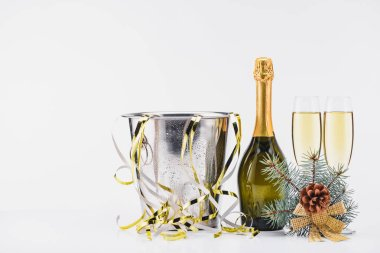 Close up view of bucket with confetti, bottle and glasses of champagne on grey backdrop stock vector