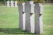 Fényképek identical old memorial headstones placed in row at graveyard