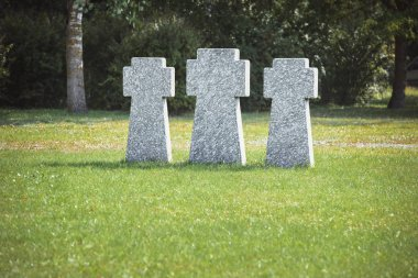 Memorial stone crosses placed in row on grass at graveyard stock vector