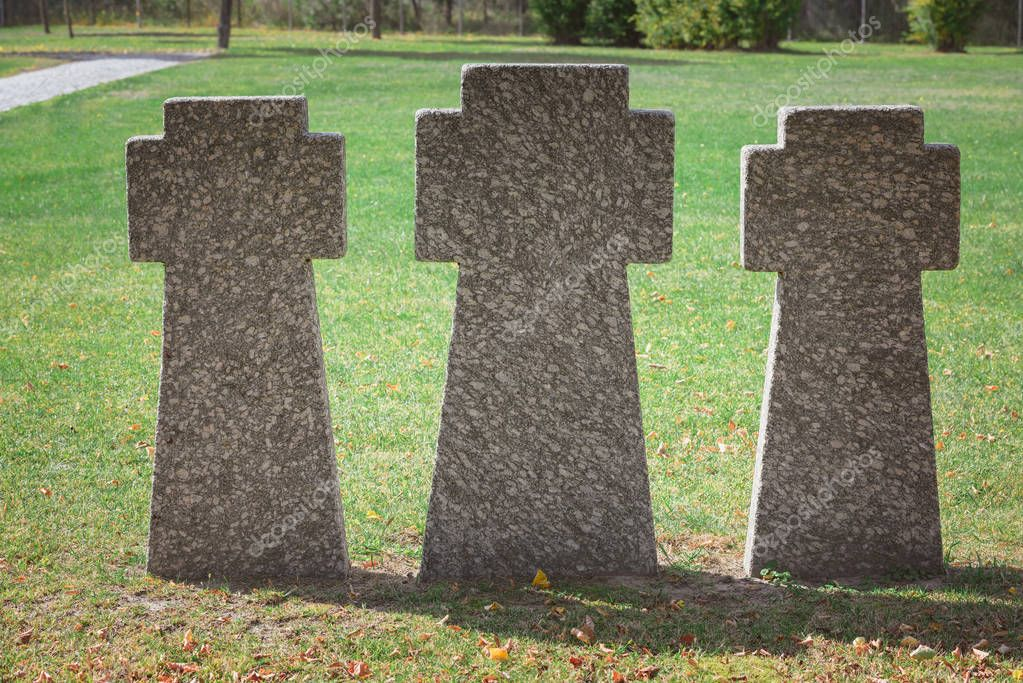 Close up image of memorial stone crosses placed in row at graveyard stock vector