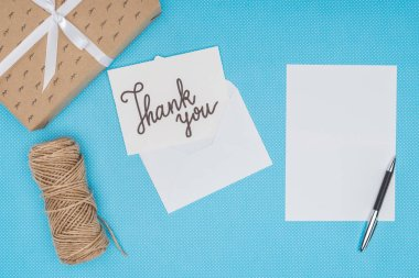 White postcard with thank you lettering and blank sheet isolated on blue background stock vector
