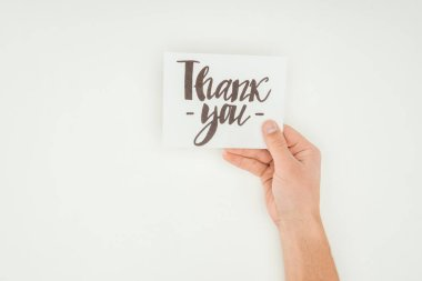 cropped view of person holding white postcard with thank you lettering isolated on white background