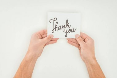 Hands holding thank you lettering on white postcard isolated on white background stock vector
