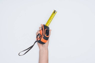 Cropped shot of woman holding measuring tape tool isolated on white stock vector