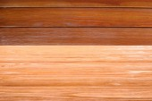 Photo template of orange wooden floor with brown planks on background