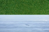 template of light blue wooden floor with green grass on background