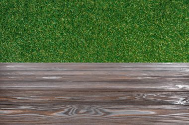 Template of brown wooden floor with green grass on background stock vector