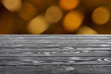 Template of grey wooden floor on blurred orange background stock vector