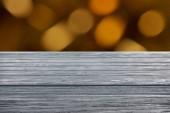 Fotografie template of grey wooden floor with blurred orange background