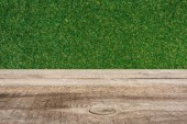 template of brown wooden floor and green grass on background