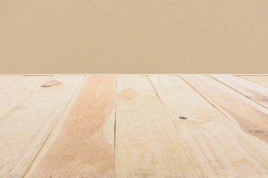 template of beige wooden floor made of planks on dark beige background