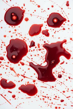 top view of messy blood splashes on white