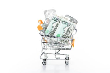 trolley cart with russian cash money and empty pills packages isolated on white