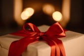 present with red bow on blurred background