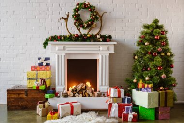 festive living room with cozy fireplace, christmas tree and presents