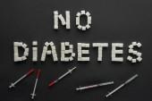 žádná cukrovkanápisy z kostek cukru s inzulínovému Peru na černém pozadí