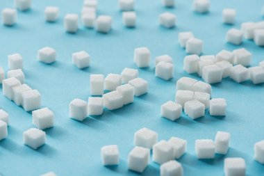 white sugar cubes on blue background