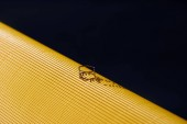 Fotografie beautiful luxury ring on yellow and black striped surface
