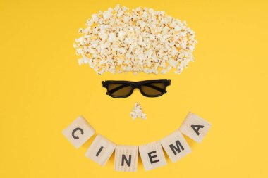 Stereoscopic 3d glasses, popcorn and cubes with