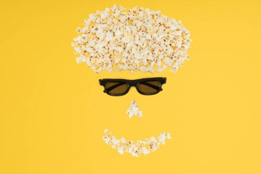 Stereoscopic 3d glasses and fresh popcorn isolated on yellow stock vector