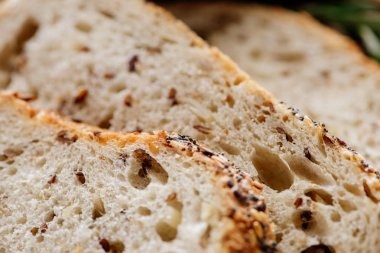 close up view of fresh sliced grain bread with seeds