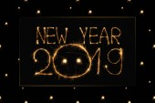 close up view of 2019 new year light sign on black background
